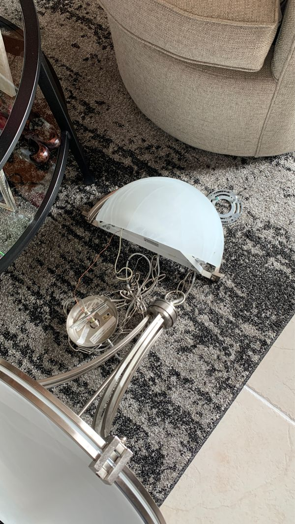 Matching hanging light and wall sconce gently used.