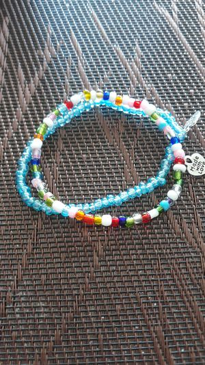 "Handcrafted Hildie & Jo. glass bracelet with a charm ""made with love"" (set of 2) for Sale in Montclair, CA"
