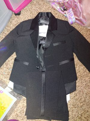 Black suit size 12 months. Worn once includes white long sleeve black vest black jacket and pants for Sale in San Antonio, TX