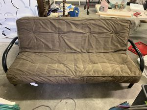 Futon. A couch and also turns into a bed. Couple scratches but works great! for Sale in Livermore, CA