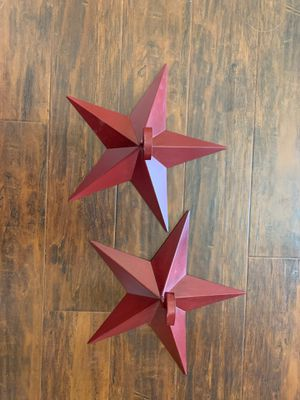 Wall decor. Two red stars with candle holders for Sale in Las Vegas, NV