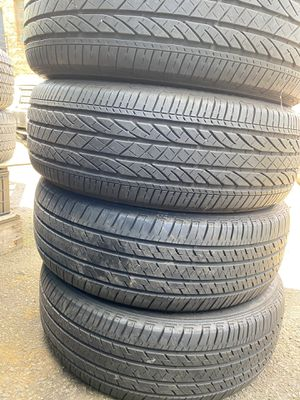 Set 4 usted tire 235/60R18 BRIDGESTONE two have patch set 4 used tire $200 for Sale in Alexandria, VA