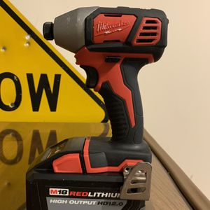 Milwaukee impact gun and battery for Sale in Framingham, MA