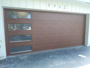 Garage door repairs ;Broken springs;New openers .Accordions shutters news;and fixs old ones.Commercial doors,RRolling doors. for Sale in Hollywood, FL