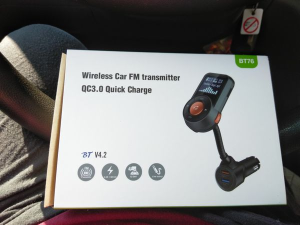Wireless car FM transmitter with quick charge port