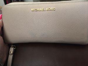 Michael kors wristlet wallet light pink for Sale in Windcrest, TX