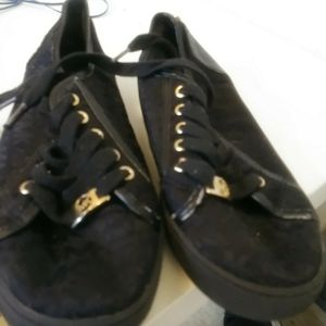 Black Michael Kors sneakers size4 for Sale in Chicago, IL