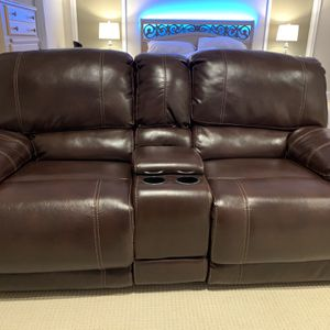 Used like new - Faux Leather Reclining loveseat with Console for Sale in Canton, MI