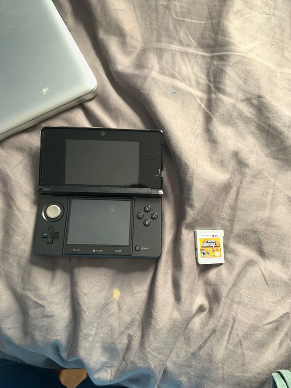 Nintendo 3DS with charger and super Mario game
