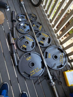 Weights Olympics and bar +2 barbell $140 for Sale in Renton, WA