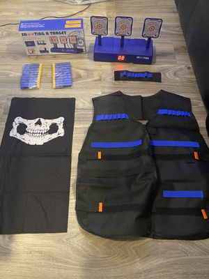 Electronic Shooting Targets for Nerf type guns with accessories (mask, vest, bullets and wrist band) for Sale in Dallas, TX