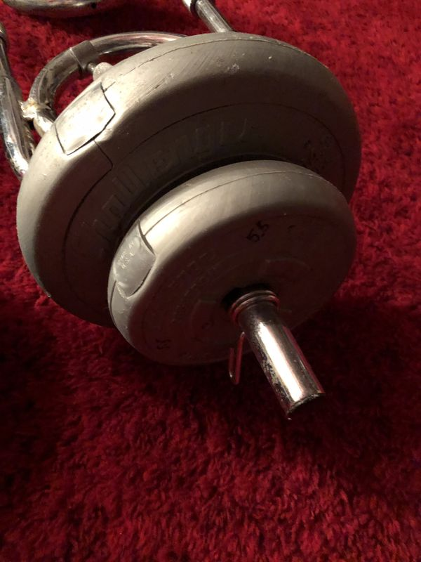 Weight set. Multi grip barbell with 10 plates