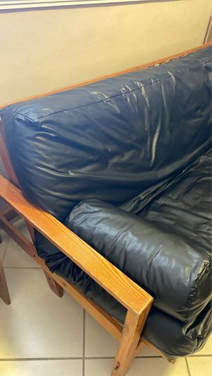 Futon with leather covering for Sale in Hialeah, FL