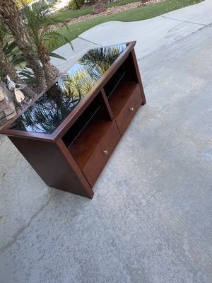 Beautiful heavy tv stand with drawers and shelves heavy dark black glass on top see all pictures for measurements please for Sale in Wildomar, CA