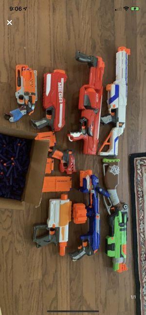 Nerf guns with 300 hundred blue bullets and 60 mega dart bullets. for Sale in Cumming, GA