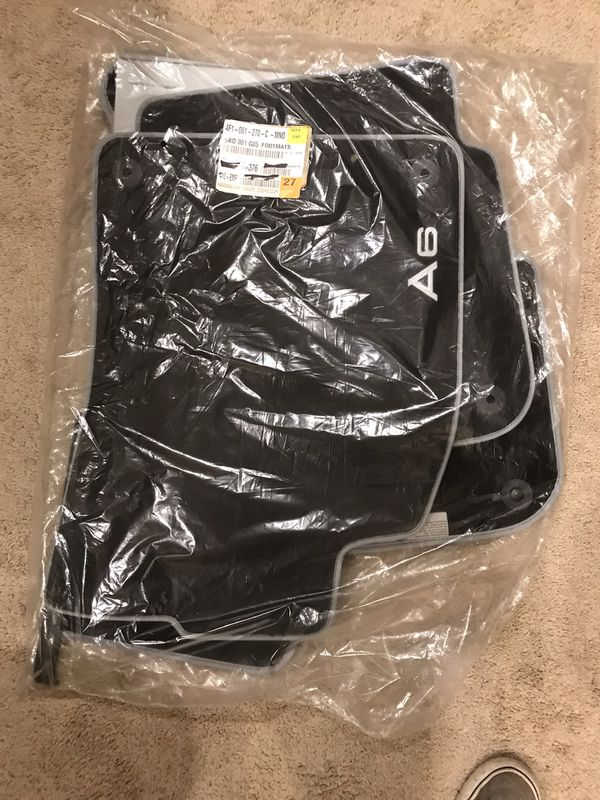 Audi A6 set of floor mats. Black cloth w/silver piping. BRAND NEW