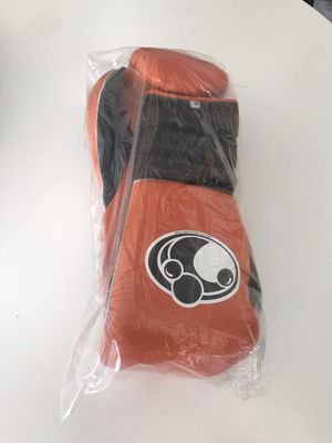 Orange grant professional boxing gloves for Sale in Las Vegas, NV