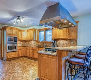 Wood Kitchen cabinets with granite stone ( includes sink, eat-in island ). Does not include appliances for Sale in North Brunswick Township, NJ