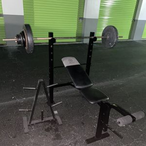 Bench Press With 100lbs Of 1 Inch Standard Weights And Tree for Sale in Fort Lauderdale, FL