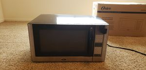 Oster stainless steel microwave for Sale in Clovis, CA