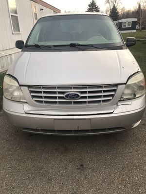 2002 ford wind start van 7 . Has over 200000 miles starts perfect runs good okay condition seats in great condition has some rust as you can see in p for Sale in Lansing, MI