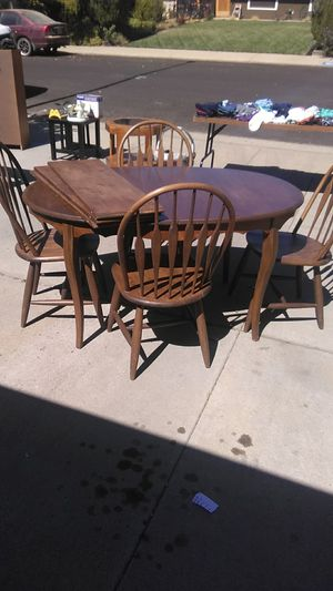 Dinning table and chairs . Entertainment shelf. Book cabnet . Small table's. Kids clothes. for Sale in Modesto, CA
