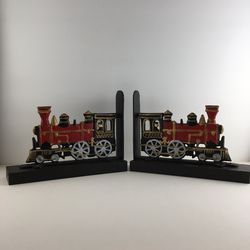Vintage Cast Metal Train Locomotive Bookends for Sale in Navasota,  TX