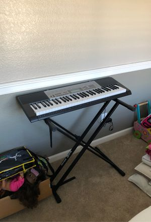 Keyboard and xfinity rock jam stand for Sale in Clovis, CA