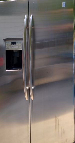 GE stainless steel side by side refrigerator need gone please read add for Sale in Oswego, IL