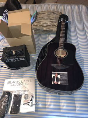 Brand new Keith Urban electric acoustic guitar with amplifier and 30 songs 30 days platinum disc Christmas 🎄 for Sale in Plant City, FL
