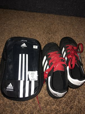 Kids Adidas cleats (size 12) and shin guards (size xs) for Sale in San Marcos, CA