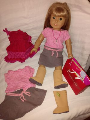 American Girl doll with extra clothes. Good condition for Sale in Santa Ana, CA