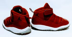 pair of red Air Jordan 11's for Sale in Nashville, TN