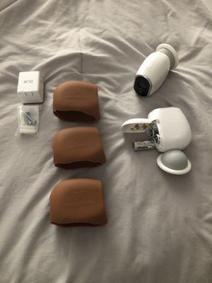 2 arlo cameras with mounts, 1 rechargeable battery and 3 silicone skins for Sale in Mesa, AZ