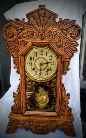 Oak antique clock , restored case dates to 1894 works great strikes hour and half hr. for Sale in Miami Beach, FL