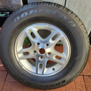GOODYEAR EAGLE LS Tire on a Factory Jeep Rim in Mint condition. 245/70R 16 - ONE TIRE ONLY for Sale in Anaheim, CA