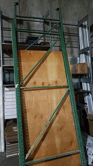 Free Green metal uprights for warehouse shelving for Sale in Colorado Springs, CO