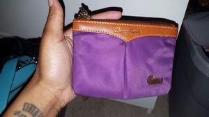 Dooney and burke wristlet for Sale in Hanover, MD