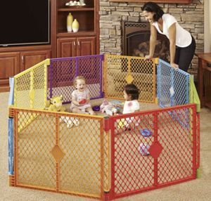 Toddleroo by North States Superyard Colorplay 8 Panel Baby Play Yard: Safe play area anywhere. Folds up with carrying strap for easy travel. Freestan for Sale in Las Vegas, NV