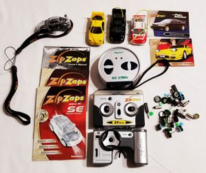 Lot of Radio Shack Zip Zaps Cars, Parts, and Case for Sale in Parma, OH