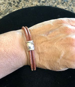 Cool leather bracelet with silver accent bead, Fits small to medium size wrist. Gently worn. for Sale in Tolleson, AZ