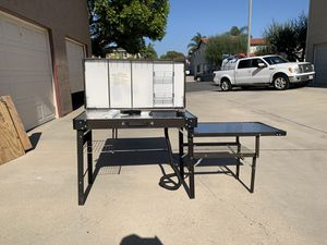 Vintage Coleman portable kitchen with sink, table, and checker/backgammon top. for Sale in Huntington Beach, CA