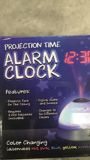 Color changing alarm clock. Show time on the ceiling in 6 colors. 3 AAA Batteries INCLUDED. KIDS WILL LOVE IT!! for Sale in Pembroke Pines, FL