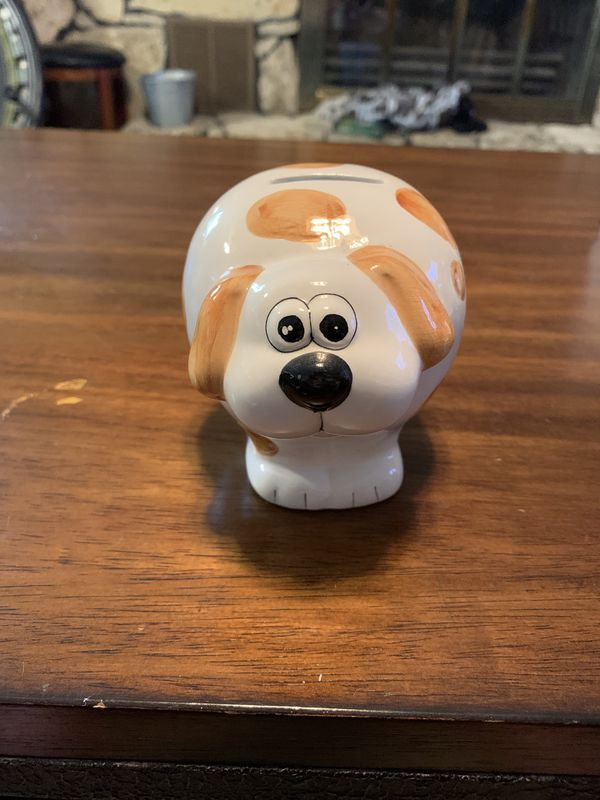 Brown and white dog piggy bank