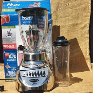 NEW OSTER Chrome12 Speed Blender with 6 cup Glass Jar and 20 Oz Planstic Blend- n- go Smoothie cup for Sale in Los Angeles, CA