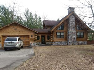 Log home on private lake for Sale in Irons, MI