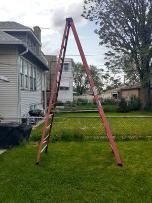 WernerNXT 12-ft Fiberglass Type 1A - 300 lbs. Capacity Step Ladder for Sale in Chicago, IL