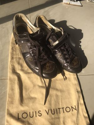 Authentic Louis Vuitton Tennis shoes fit size 7-8 price firm like new condition comes with dust bag and box for Sale in Arlington, TX