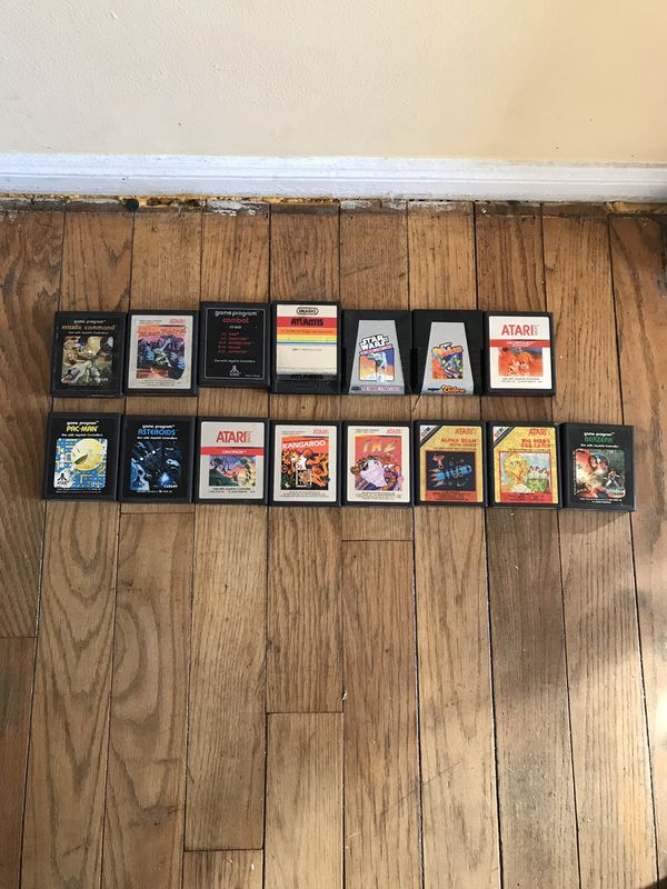 Vintage Atari 2600 with controllers and 15 Cartridge Games