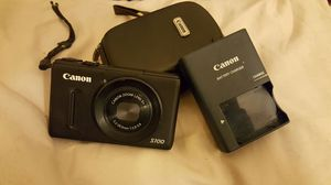 High end Canon camera (<s100> zoom lens 5x is)with a canon battery charger and canon camera case for Sale in Antelope, CA